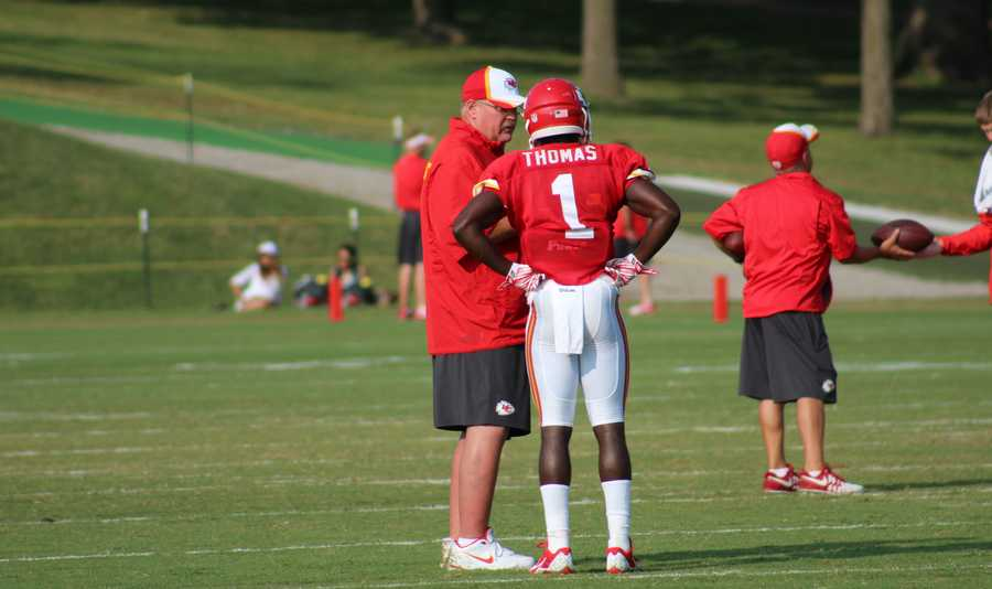 Photos from Chiefs training camp Thursday morning at Missouri Western State University.  Coach Andy Reid chats with rookie running back De'Anthony Thomas.