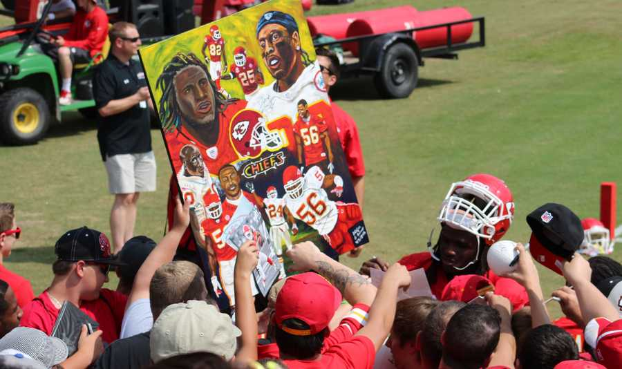 Photos from Chiefs training camp Thursday morning at Missouri Western State University. Players sign autographs for fans after practice.  Running back Jamaal Charles signs a painting by artist and Chiefs fan Stefan J.