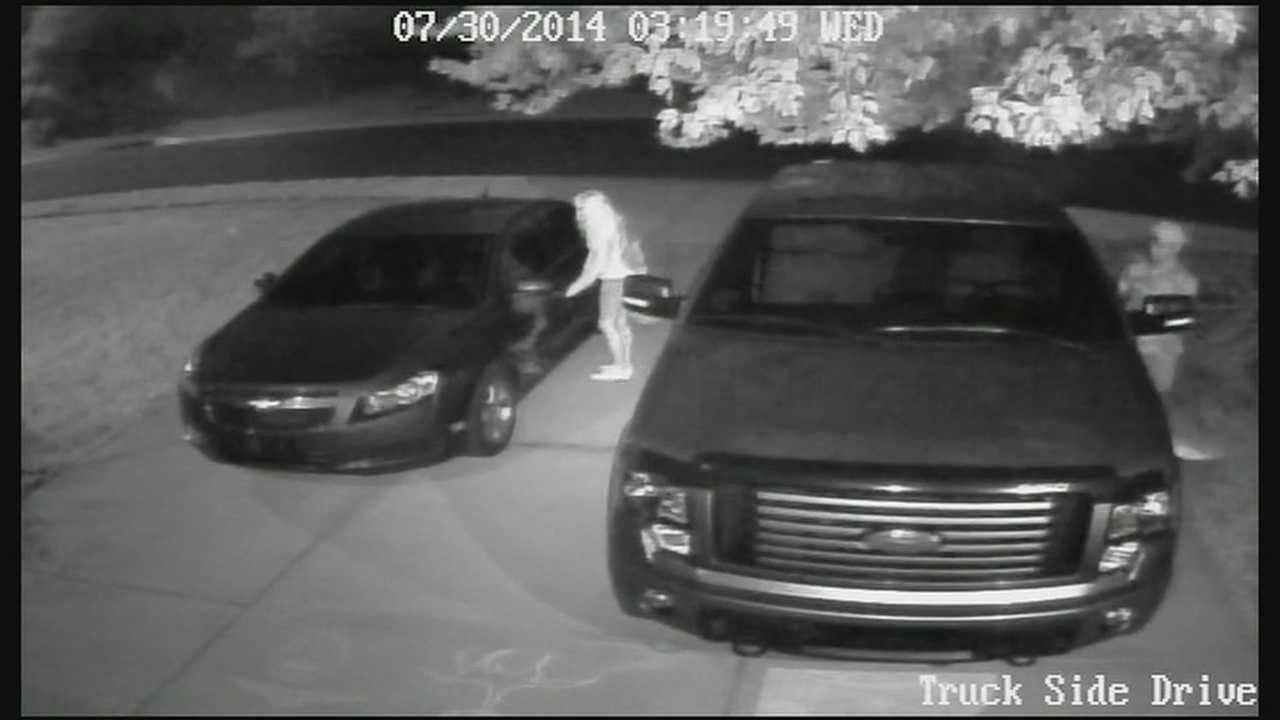 Two strangers were caught on camera as they tried to break into a Shawnee, Kan., man's vehicles.