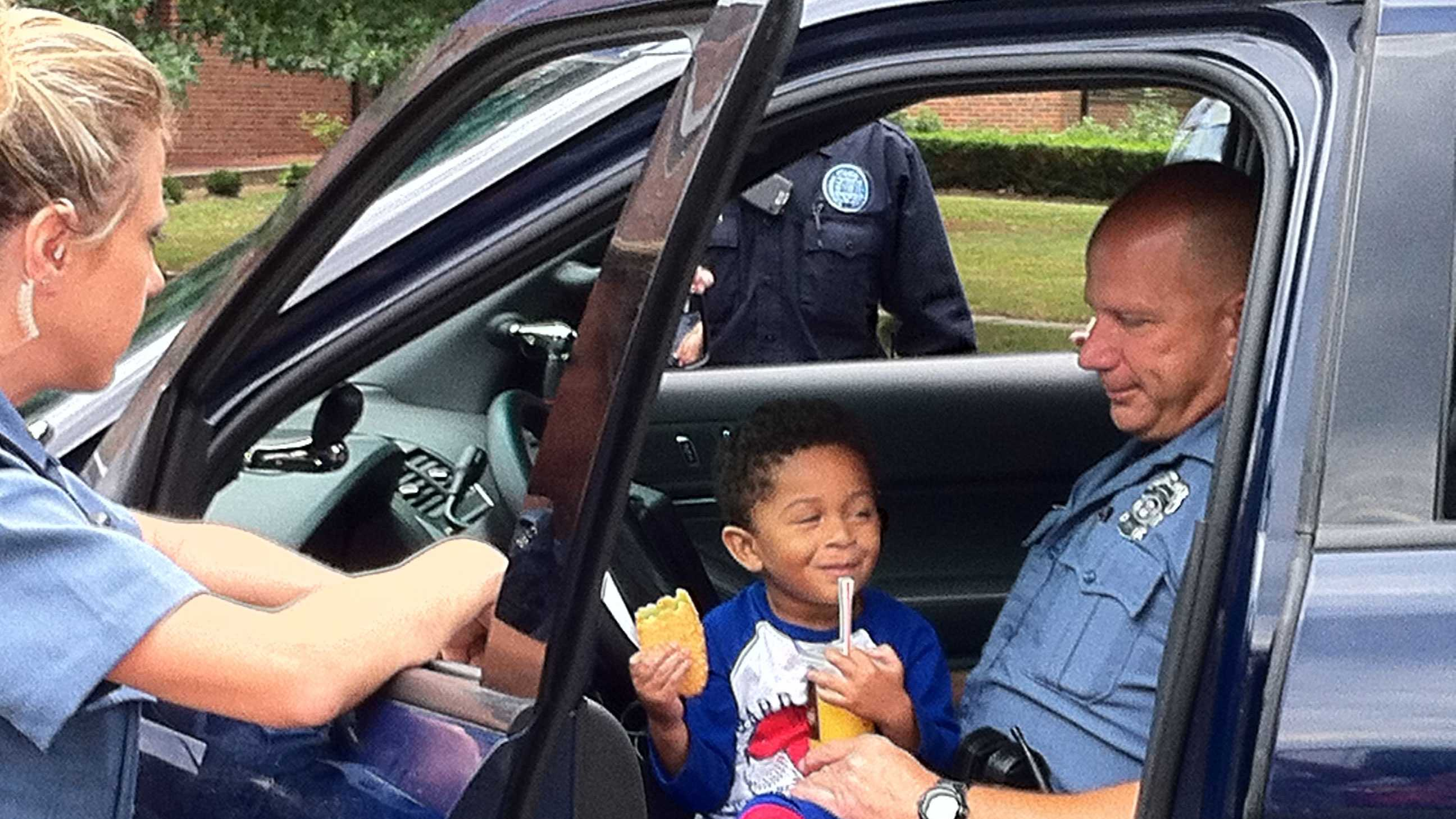 Lost boy entertained by officers