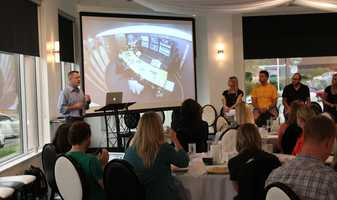"Photo shows Gatorade's social media ""mission control"" center. VML's Gatorade account team gave a presentation called #OwningYourHashtag.  VML is a full-service digital marketing agency with clients worldwide.  The SMCKC meeting was held at the Grand Street Cafe in Kansas City."