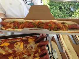 """The Hot Dog Festival features signature hot dogs from 11 Major League ballparks, including the Texas Rangers' two-foot monster dog called the """"Boomstick."""""""