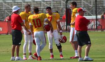 The Kansas City Chiefs practice a final time from training camp before their first preseason game versus the Cincinnati Bengals Thursday. Quarterbacks Alex Smith, Chase Daniel, Aaron Murray and Tyler Bray talk on the field.