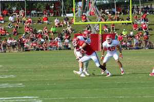 The Kansas City Chiefs practice a final time from training camp before their first preseason game versus the Cincinnati Bengals Thursday. Rookie Dee Ford lines up at defensive end.