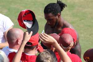 The Kansas City Chiefs practice a final time from training camp before their first preseason game versus the Cincinnati Bengals Thursday. Veteran receiver Dwayne Bowe signs autographs after practice.