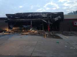 Rioters destroyed a gas station in Ferguson, Mo., overnight after a vigil for an 18-year-old shot and killed by police.