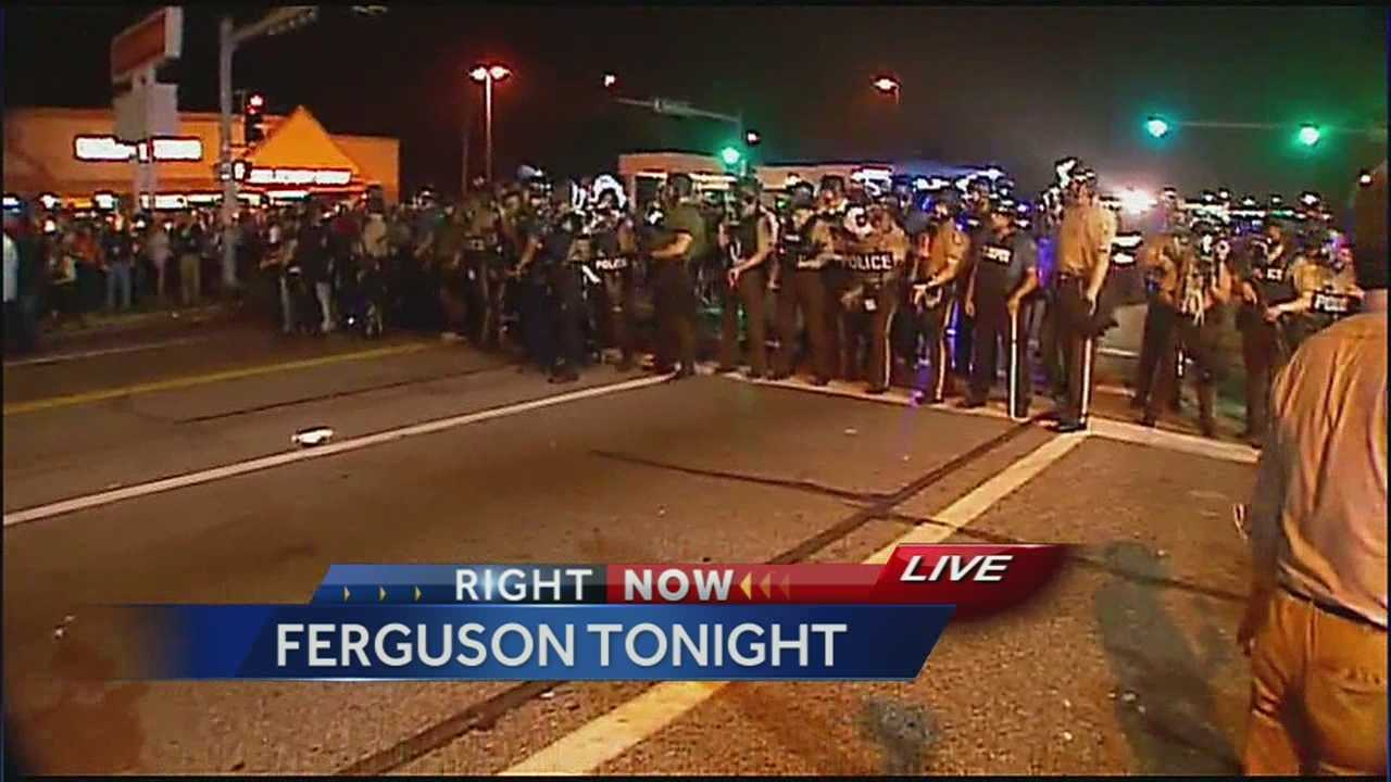 Image Police at Ferguson clash with protesters