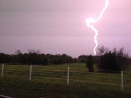 "Steve Welch says:  ""There was a beautiful sunrise this morning in Spring Hill and I went to feed the horses as usual and then next thing I knew, I was trapped in the barn with lightening all around."""