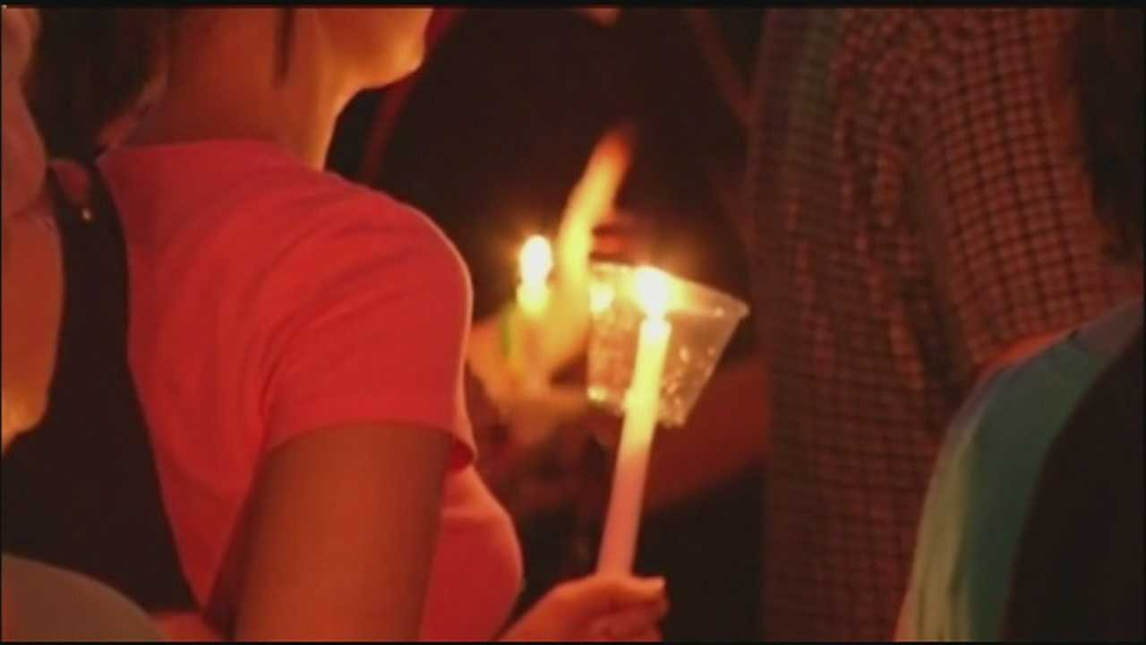 A vigil Monday night in Topeka helped the community to remember and honor the sacrifices of a police officer who was shot during a traffic stop Sunday afternoon.