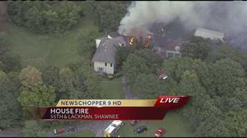 Images from a large house fire at 5450 Lackman Road on Wednesday afternoon.