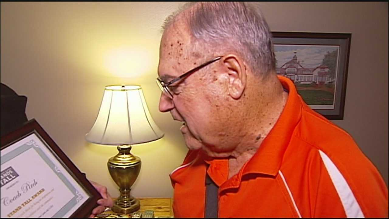 A longtime assistant football coach in Oak Grove, George Pirch, was surprised to be one of the 10 recipients of the Stand Tall Award for the way he has inspired so many people over the course of his career.