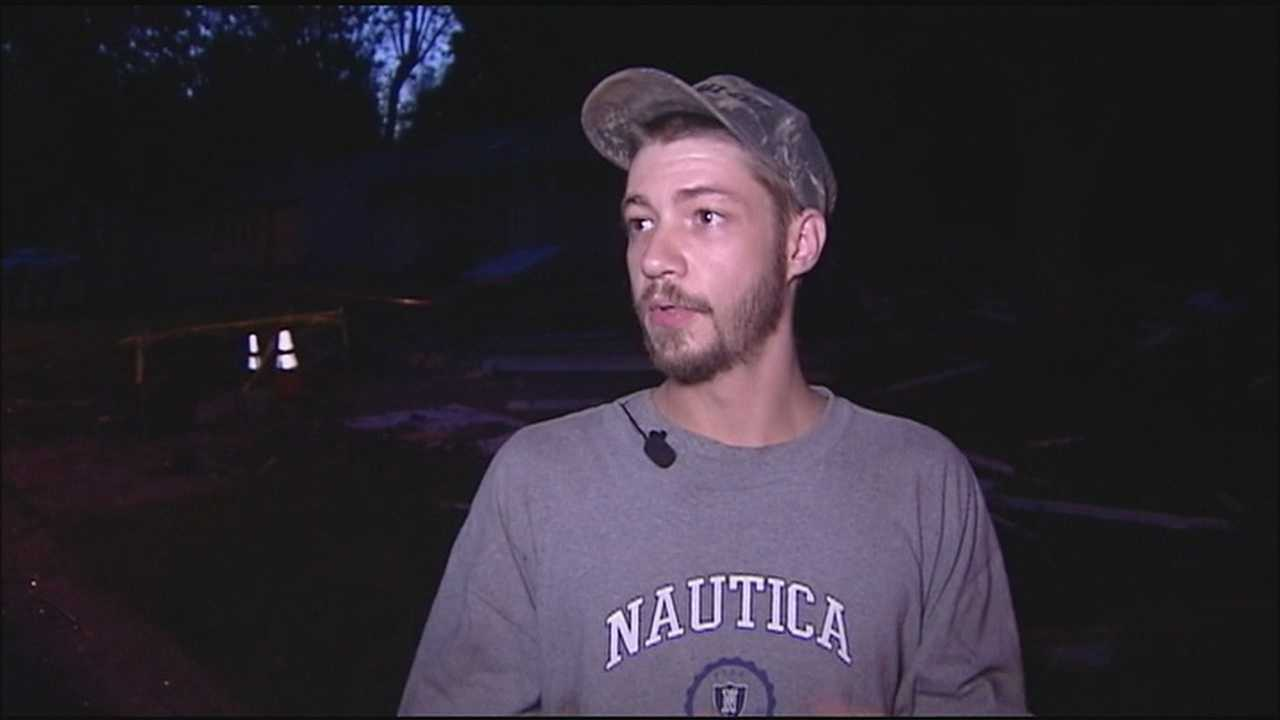 A man who lives in a southeast Kansas City neighborhood where a vacant house exploded Wednesday night described how he rushed in to help an injured woman.
