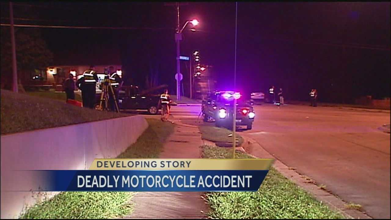A motorcyclist dies after his bike crashed into a vehicle on Kansas City's east side.