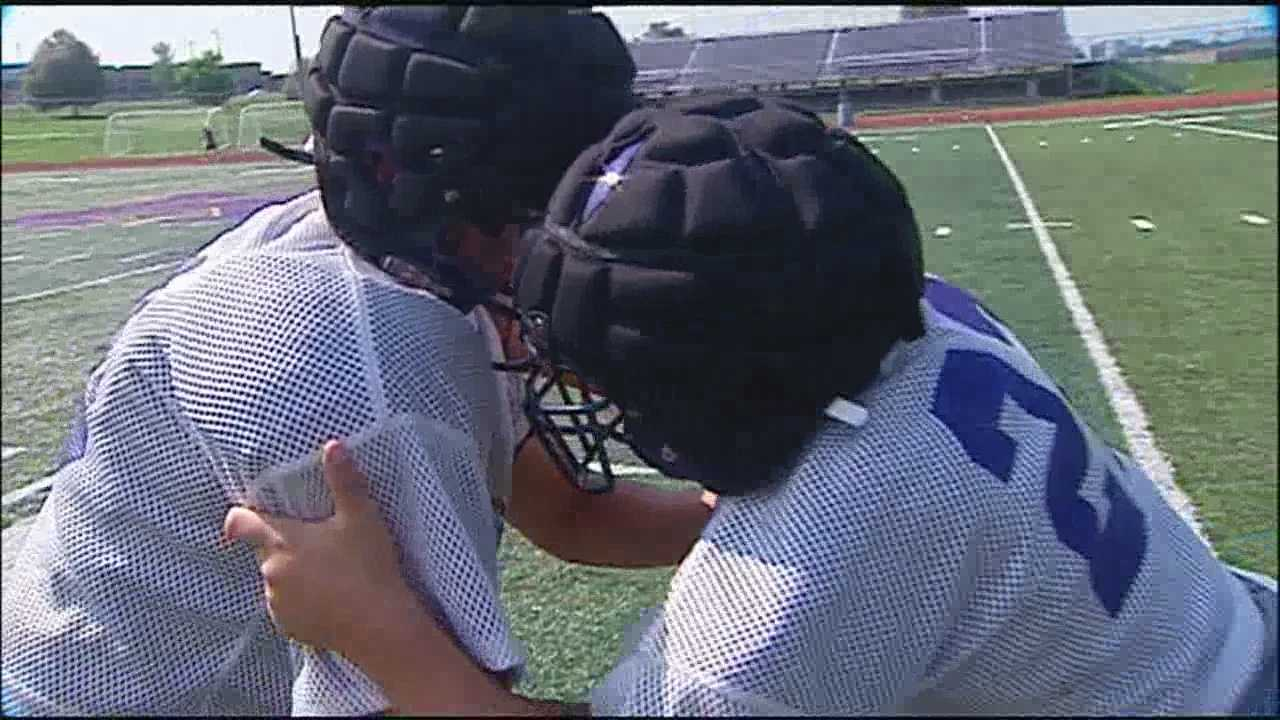 In an effort to prevent high school football players from getting concussions in practice, some schools are trying out a new cap that goes over the player's head.