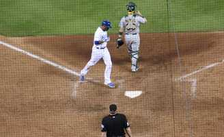The Kansas City Royals host the Oakland Athletics in the AL Wild Card game.  Alcides Escobar scores on a Lorenzo Cain single.  The Royals score three runs in the eighth inning to cut the lead to 7-6.