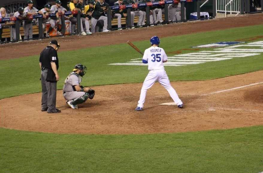 The Kansas City Royals host the Oakland Athletics in the AL Wild Card game. Eric Hosmer approaches the plate before hitting a triple.