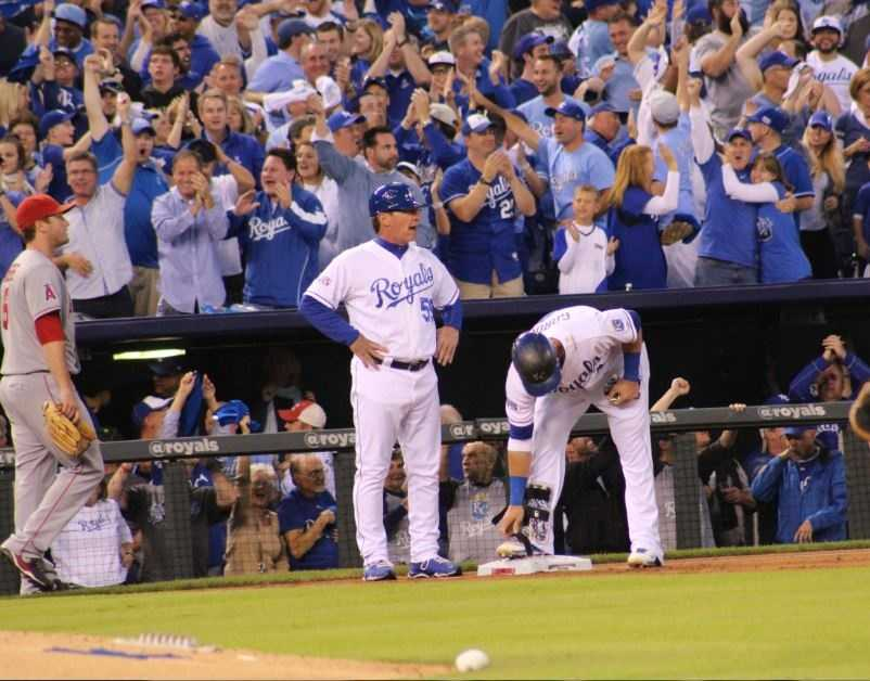 Royals host the Angels in Game 3 of the ALDS.  Royals left-fielder Alex Gordon hits a 3-run double and reaches third base on a throw to home.