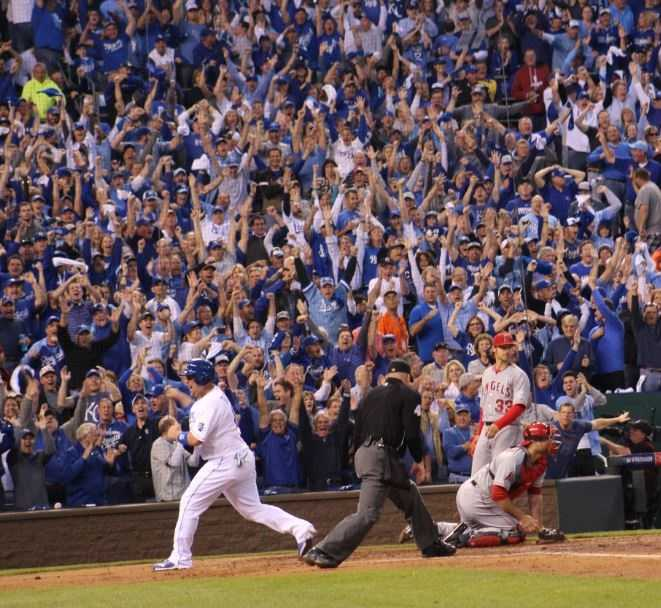 Royals host the Angels in Game 3 of the ALDS.  Royals left-fielder Alex Gordon hits a 3-run double and reaches third base on a throw to home.  Billy Butler pumps his fist after scoring a run.