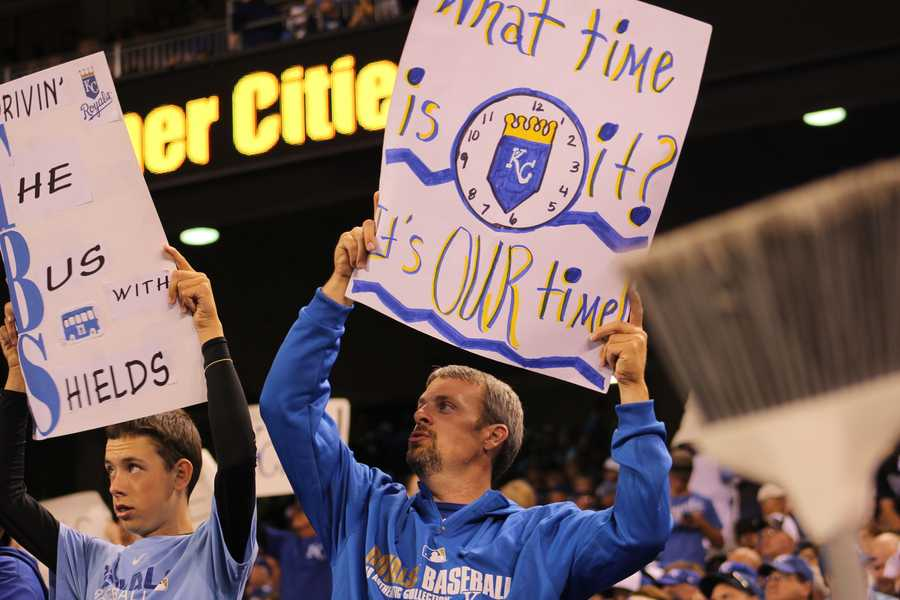 Royals host the Angels in Game 3 of the ALDS.  Royals fans brought their brooms and signs of hope.  Prior to this game, Kansas City had not won an MLB playoff series since 1985.