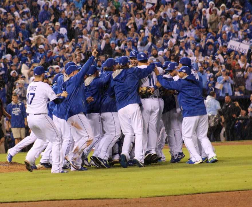 Royals host the Angels in Game 3 of the ALDS.  As he had done all season, Royals win by a score of 8-3.  Kansas City rejoices after sweeping the ALDS in three games.  A rain shower dowses the players before champagne would in the clubhouse.