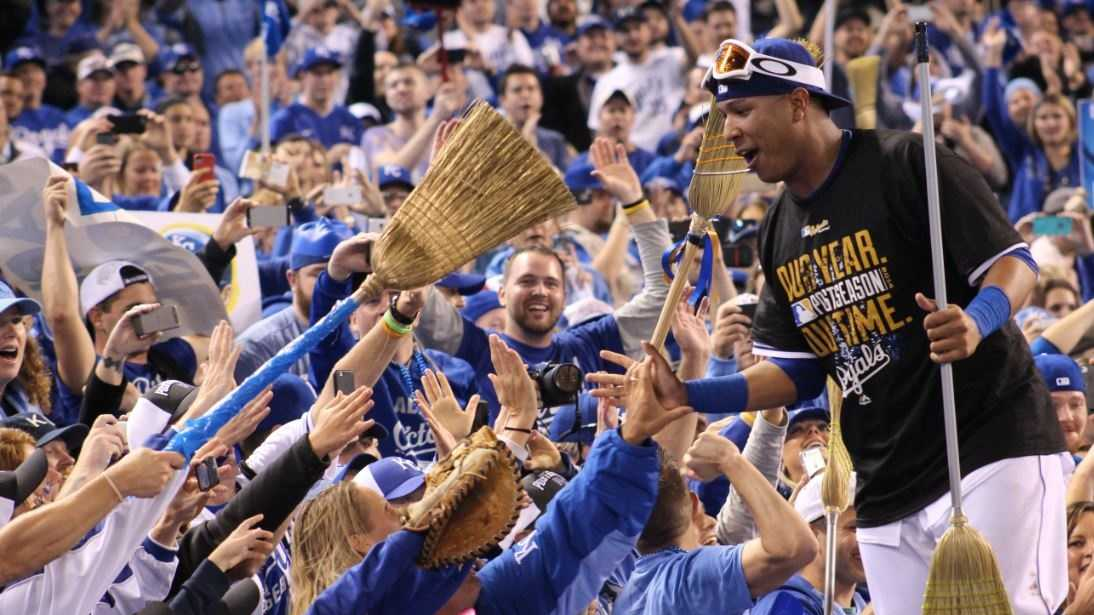 Royals host the Angels in Game 3 of the ALDS.  As he had done all season, Royals win by a score of 8-3.  Kansas City rejoices after sweeping the ALDS in three games.  Royals catcher Salvador Perez celebrates atop the dugout.