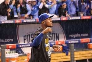Royals host the Angels in Game 3 of the ALDS.  As he had done all season, Royals win by a score of 8-3.  Kansas City rejoices after sweeping the ALDS in three games.  Royals outfielder Jarrod Dyson pumps his fist in the rain.