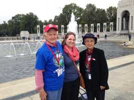 Heartland Honor Flight veterans visit the World War II Memorial in Washington, D.C.  John Atkins, Elizabeth Atkins, and Therese Park tour the site together.