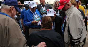 Heartland Honor Flight veterans visit the World War II Memorial in Washington, D.C.  Senator Bob Dole meets with veterans.