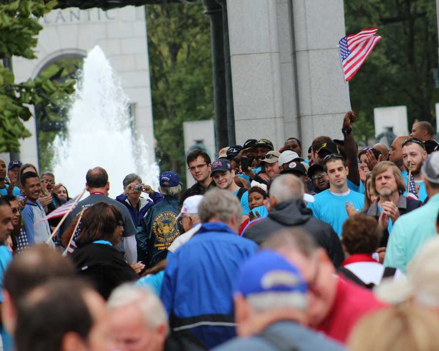 Heartland Honor Flight veterans visit the World War II Memorial in Washington, D.C. A crowd of everyday citizens thanked the veterans for their service.
