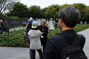 Heartland Honor Flight veterans visit the Korean War Memorial.  Therese Park (far right) was a 9-year-old school girl when she says American soldiers protected she and her classmates in South Korea.