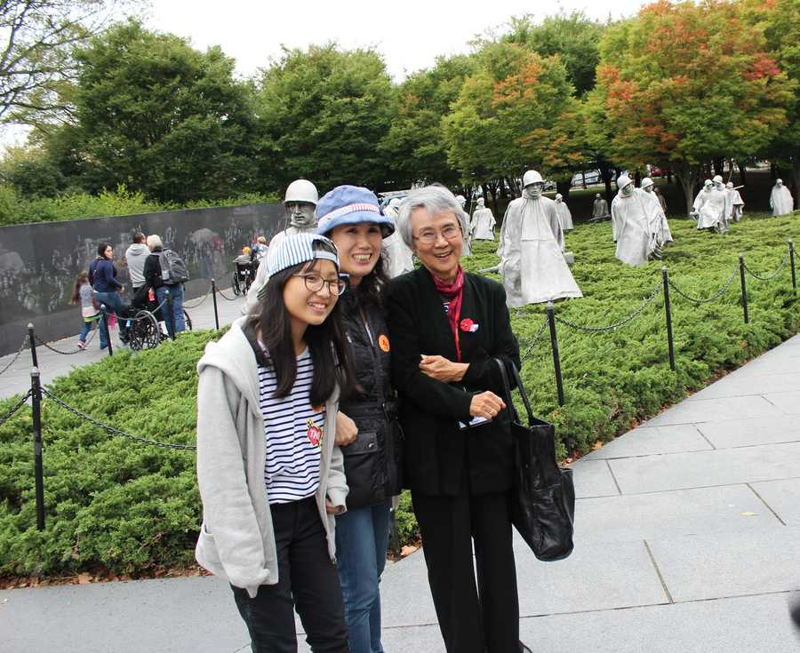 Heartland Honor Flight veterans visit the Korean War Memorial. Therese Park (far right) was a 9-year-old school girl when she says American soldiers protected she and her classmates in South Korea. Tuesday she met a group of people who grew up in the neighboring town that she did.