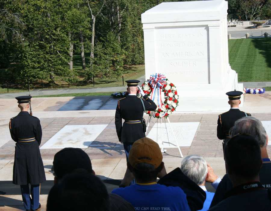 According to the Arlington National Cemetery, the gift of flowers at a memorial is a tribute made each day.  More formal ceremonies involve the laying of a wreath and the attendance of others at this ritual.