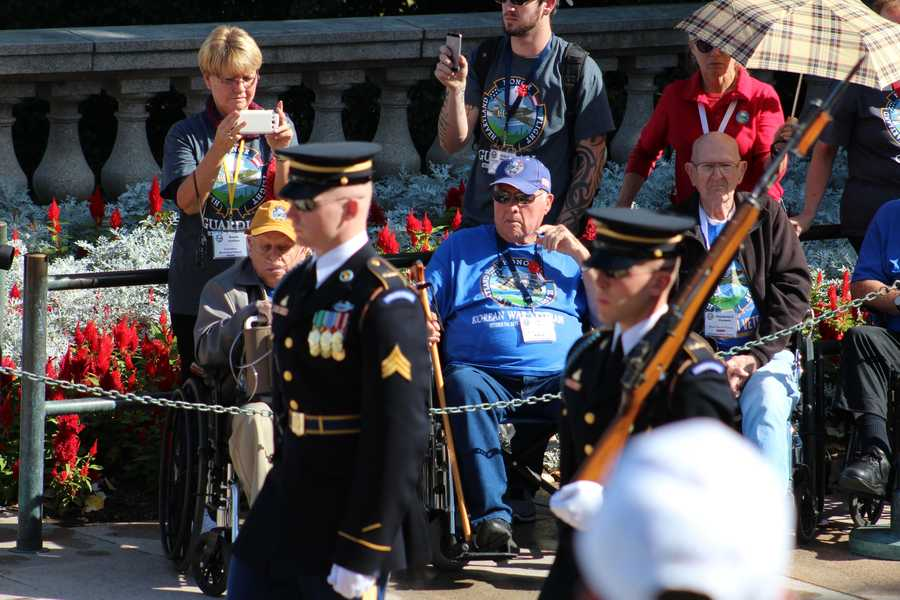 Heartland Honor Flight members watch their fellow veterans lay a wreath at the Tomb of the Unknowns at Arlington National Cemetery.