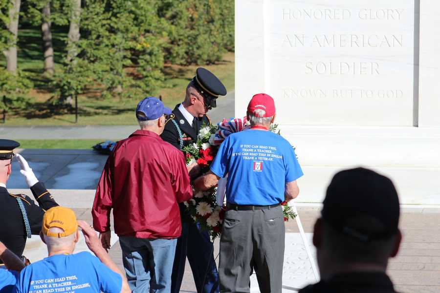 Heartland Honor Flight veterans Lou Ramsey, Bob Jones, Charlie Siebert and Richard Hyder lay a wreath at the Tomb of the Unknowns.