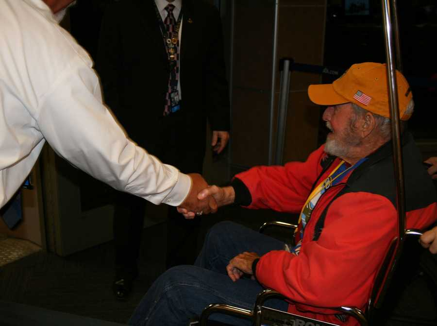 Security agents and American Airlines workers wished veterans a good trip as they board the Heartland Honor Flight at KCI.