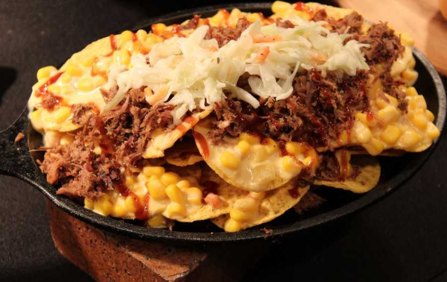 Layer on the toppings as your Royals layer on more runs.  This Cheesy Corn Brisket-acho piles smoked brisket, baked beans, cheesy corn, coleslaw and barbecue sauce on top of tortilla chips.  Find them at the KC Cantina or Sweet Baby Ray's locations throughout the K.
