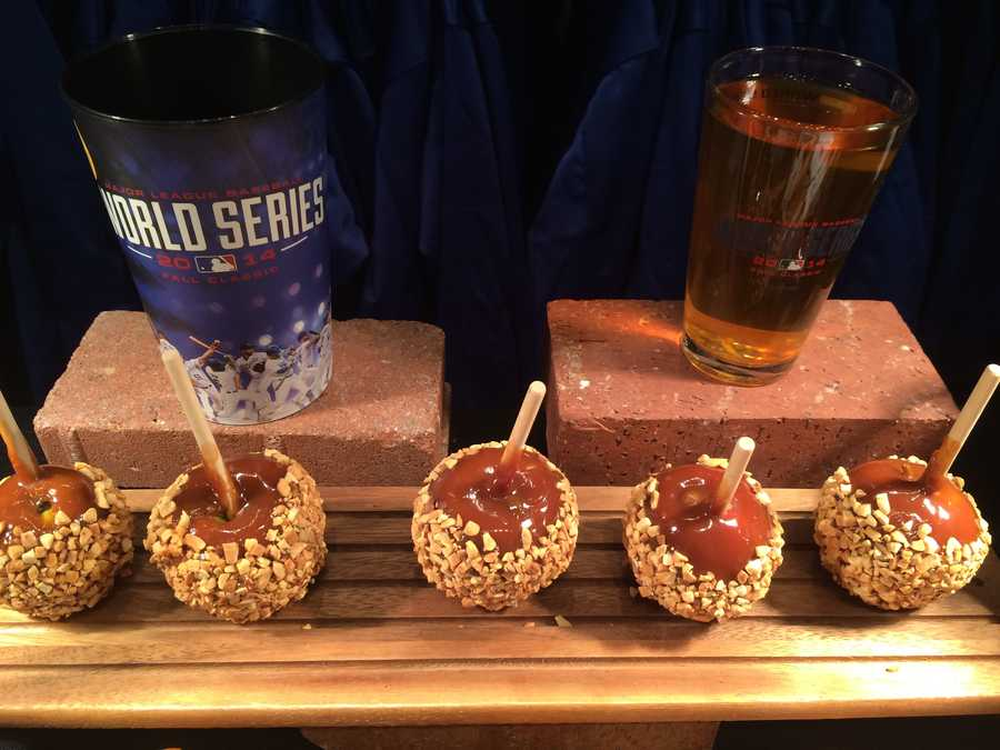 Caramel apples with toasted peanuts.