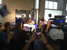 The crowd gathered to greet Sung Woo back to the United States included fellow Kansas City Royals fans and the media.