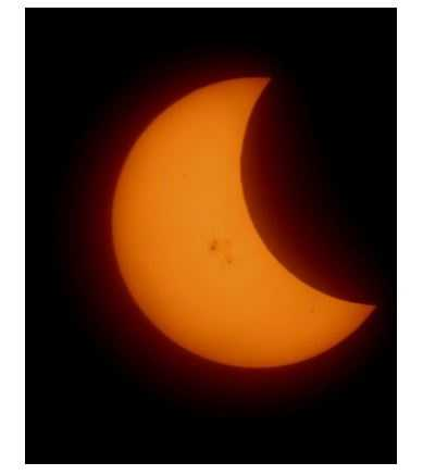 Many photos from the Sacramento area, including this one, show a bright orange sun surrounded by darkness.