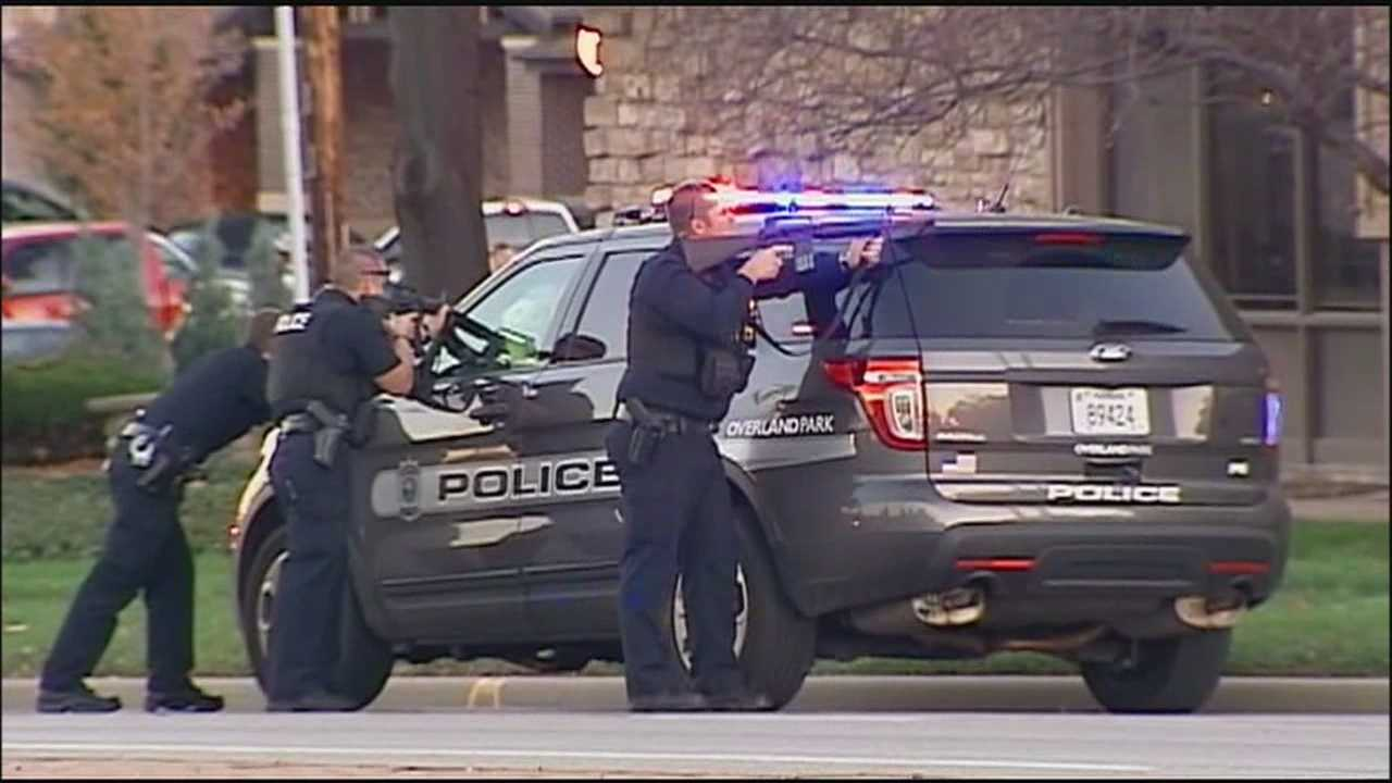 Two people have been taken into custody after a robbery at a Bank of America branch at 95th Street and Mission Road in Overland Park.