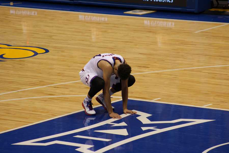 Sophomore guard Brannen Greene suffered a concussion, according to the University of Kansas Athletics.  Here you see him react after receiving a shot to the face.