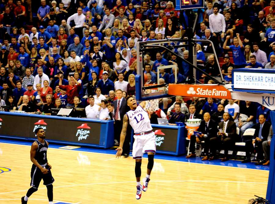 Kelly Oubre Jr. puts the icing on the cake for Kansas in the second half.  Jayhawk nation rose to its feet as the freshman rocked the rim on this breakaway dunk.  Kansas defeated Washburn 85-53 in exhibition play.
