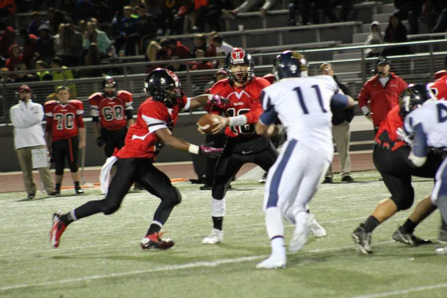 With less than five minutes left in the game, Park Hill quarterback Tyler Holmes put his legs to work.  Holmes scrambled for two large gains just moments apart.