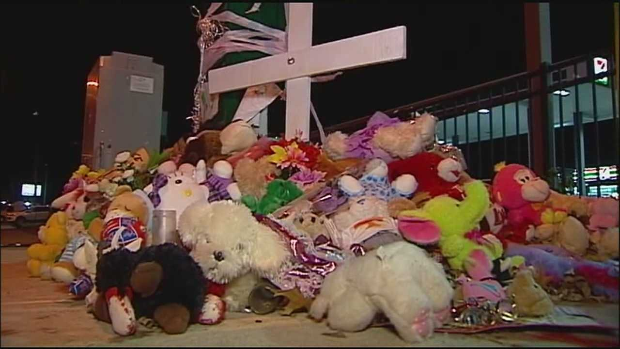 News that two men have been charged in connection with the drive-by shooting that killed 6-year-old Angel Hooper brought some feelings of relief to people who visited the memorial set up at the site where Angel died.