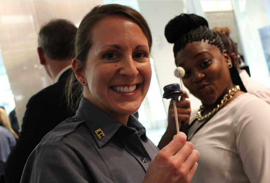 Cake-pops were served at the rededicated ceremony. A cake-pop photo-bombing clearly happened here.