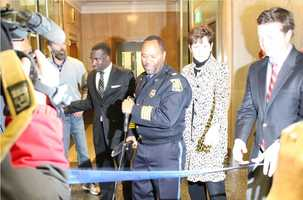 KCPD Chief Darryl Forté cuts the ribbon at the newly remodeled police headquarters.