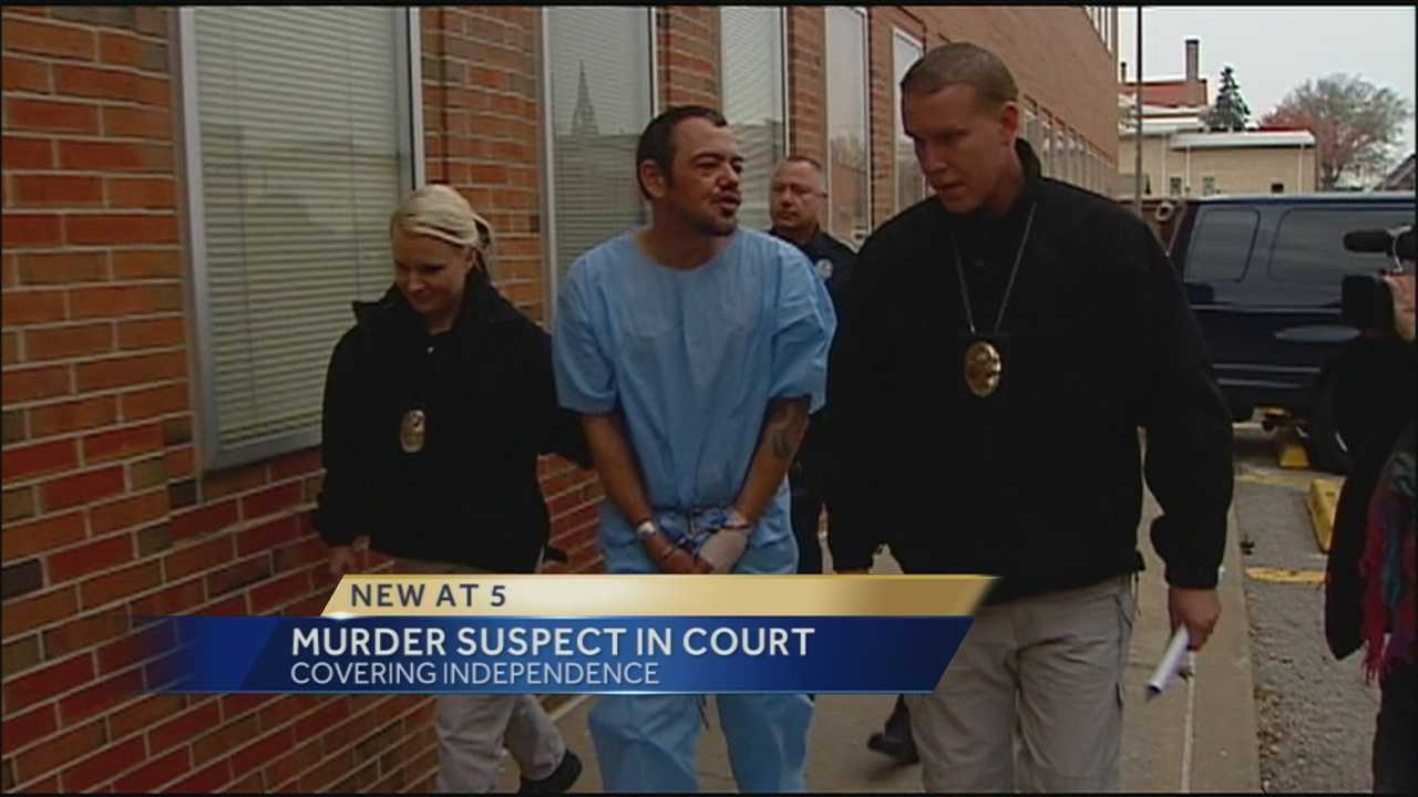 A man accused of shooting another man to death at an Independence gas station yells to reporters.