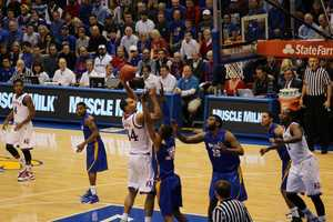 Junior Perry Ellis scored 13 points including one of his familiar soft hook shots. Kansas won by a final score of 69-59.