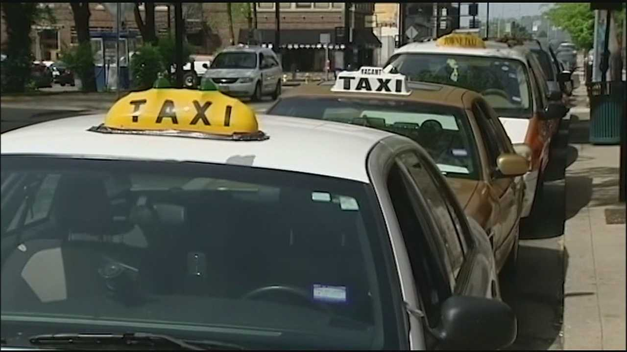 Ridesharing services Uber and Lyft are trying to work out a dispute with Kansas City's cab companies who want them to face the same rules and regulations as traditional taxis.