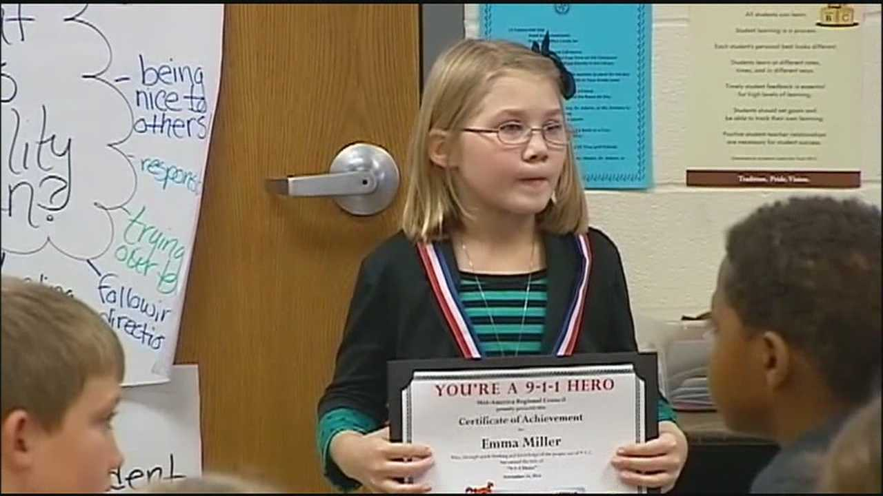 An 8-year-old girl who kept calm during a crisis involving her mother received a big award Monday.